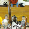 Globe/T. Rob Brown<br /> Joplin's Charlie Brown shoots under the basket against Webster Saturday afternoon, Jan. 5, 2013, at MSSU's Young Gymnasium.