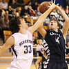Globe/T. Rob Brown<br /> Riverton's Grant North defends against a Galena shooter during Tuesday night's game, Jan. 8, 2013, at Riverton's gymnasium.
