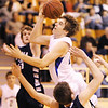 Globe/T. Rob Brown<br /> Riverton's Gavin Forbes knocks Galena's JC Pugsley out of the way while attempting a shot under the basket during Tuesday night's game, Jan. 8, 2013, at Riverton's gymnasium.