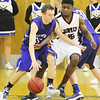 Globe/T. Rob Brown<br /> Joplin's Charlie Brown plays defense against Camdenton's John Hyde during Friday night's game, Jan. 11, 2013, at MSSU's Young Gymnasium.