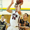 Globe/T. Rob Brown<br /> Joplin's Daniel Stokes shoots for two under the basket as William Chrisman's David Blauvelt plays defense Thursday evening, Jan. 3, 2013, during the Kaminsky Classic Boys Basketball Tournament at MSSU's Young Gymnasium.