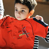 Globe/T. Rob Brown<br /> Xavier Subramaniam, 5, of Joplin, holds up his Cardinals jersey to show Al Hrabosky before asking the former St. Louis player to add his signature Saturday afternoon, Jan. 19, 2013, at MSSU's Taylor Performing Arts Center.