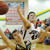 Globe/T. Rob Brown<br /> Joplin's Tucker Wallace and William Chrisman's Anthony Andrade compete for a rebound Thursday evening, Jan. 3, 2013, during the Kaminsky Classic Boys Basketball Tournament at MSSU's Young Gymnasium.