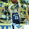 Globe/T. Rob Brown<br /> Galena's Ethan Osborn attempts a shot over Riverton defenders during Tuesday night's game, Jan. 8, 2013, at Riverton's gymnasium.