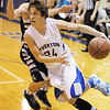 Globe/T. Rob Brown<br /> Riverton's Landon North drives toward the basket past Galena's JJ Helton during Tuesday night's game, Jan. 8, 2013, at Riverton's gymnasium.
