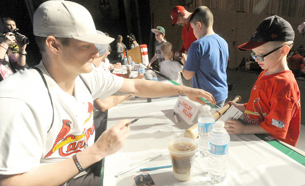 Cardinals pitcher Shelby Miller signs an autograph for Kaulden Hood, 7, of Carhage during the Cardinals Caravan on Saturday at MSSU.<br /> Globe | Laurie Sisk