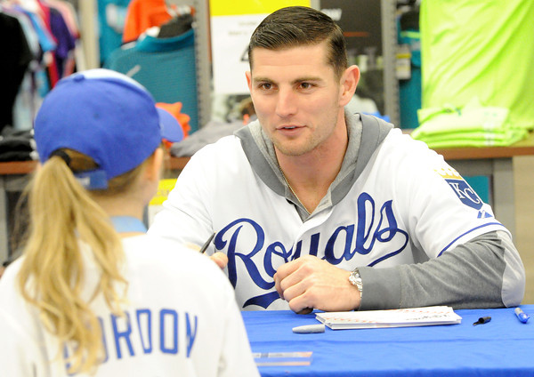 Royals infielder Johnny Giavotella chats with Laney Wilson, 5, of Carthage during the Royals Caravan stop on Wednesday night at Academy Sports.<br /> Globe | Laurie Sisk