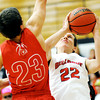 Carl Junction's Aaron Nelson puts up a shot as Webb City's Clay Gardner defends during their game on Tuesday night at Carl Junction.<br /> Globe | Laurie Sisk