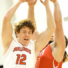 Carl Junction's Chase Johnston (12) battles Webb City's Tayler Arterbuen for a rebound during their game on Tuesday night at Carl Junction.<br /> Globe   Laurie Sisk