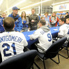 Royals fans wait their turns for autographs during the Royals Caravan stop on Wednesday night at Academy Sports.<br /> Globe | Laurie Sisk