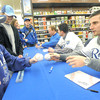 Royals infielder Johnny Giavotella signs an autograph for Will Royle, 8, Joplin, during the Royals Caravan stop on Wednesday night at Academy Sports.<br /> Globe | Laurie Sisk