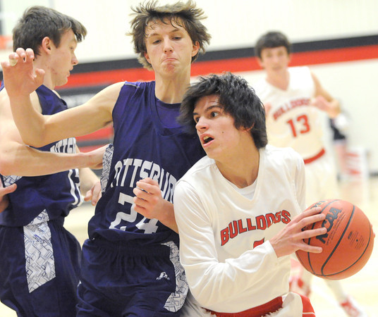 Carl Junction senior guard Gaige Crockett tries to get past Pittsburg's Kyle Smith during their game on Friday night in the CJ Classic at Carl Junction.<br /> Globe | Laurie Sisk