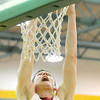 Joplin's Spencer Layne throws down a dunk off a rebound during the Eagles' game against Neosho on Tuesday night at Robert Ellis Young Gymnasium.<br /> Globe | Laurie Sisk