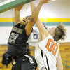 Neosho's Darrian Guillory is fouled by Webster Groves' Alex Floresca on a dunk attempt during their game in the first round of the 2014 Kaminsky Classic on Thursday afternoon at Robert Ellis Young Gymnasium.<br /> Globe | Laurie Sisk