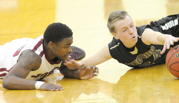 Joplin's Charlie Brown, left and Neosho's Logan Stuart vie for a loose ball during their game on Tuesday night at Robert ellis Young Gymnasium.<br /> Globe | Laurie Sisk