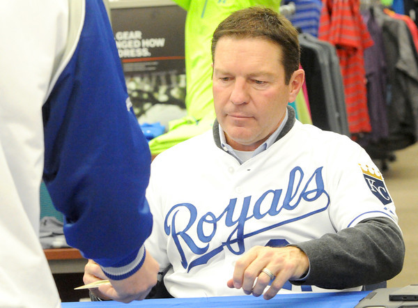 Royals analyst Jeff Montgomery signs an autograph for a fan during the Royals Caravan stop on Wednesday night at Academy Sports.<br /> Globe | Laurie Sisk