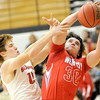 Carl Junction's Chase Johnston tries to stop Webb City's Tayler Arterburn during their game on Tuesday night at Carl Junction.<br /> Globe   Laurie Sisk