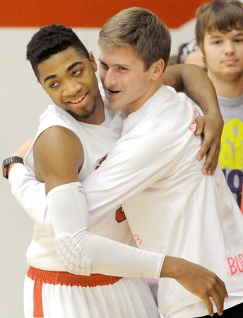 Carl Junction senior guard Matt Magee gets a hug from classmate and longtime friend Christian Pittman. Magee had just scored his 1,000 career point during the Bulldogs game against Pittsburg in the CJ Classic at Carl Junction.<br /> Globe | Laurie Sisk
