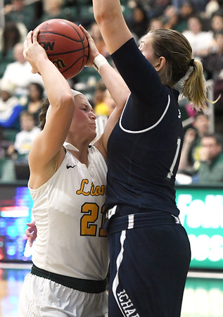 Missouri Southern's Desirea Buerge (21) gets fouled by Washburn's Axelle Bernard (1) during their game on Wednesday night at Leggett & Platt.<br /> Globe | Laurie Sisk