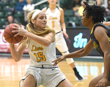 Missouri Southern's Chelsey Henry (15) looks to pass as Missouri Western's Brittany Atkins (1) defends during their game on Saturday afternoon at Leggett & Platt. Globe | Laurie Sisk