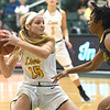 Missouri Southern's Chelsey Henry (15) looks to pass as Missouri Western's Brittany Atkins (1) defends during their game on Saturday afternoon at Leggett & Platt.<br /> Globe | Laurie Sisk