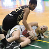 Missouri Southern's Chelsea Henry battles Emporia State's Jessica Wayne (21)for a loose ball during their game on Saturday at Leggett & Platt.<br /> Globe | Laurie Sisk