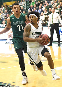 Missouri Southern's CJ Carr (0) gets past Northwest Missouri's Xavier Kurth (21) during their game on Thursday night at MSSU. Globe | Laurie Sisk
