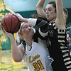 Missouri Southern's Jensen Maydew (31) looks for a shot as Emporia State's Emily Miller (44) defends during their game on Saturday at Leggett & Platt.<br /> Globe | Laurie Sisk
