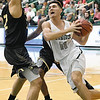Missouri Southern's Kinzer Lambert (11) tries to get past Emporia State's Jawan Emery (32) during their game on Saturday at Leggett & Platt.<br /> Globe | Laurie Sisk