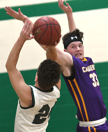 Thomas Jefferson's Andrew Corle (33) stretches to defend a shot by College Heights' Mason Baker (24) during their game on Thursday night at CHCS.<br /> Globe | Laurie Sisk