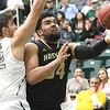 Emporia State's Garin Vandiver (34) gets past Missouri Southern's Enis Memic (12) for a score during their game on Saturday at Leggett & Platt.<br /> Globe | Laurie Sisk