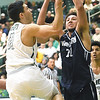 Missouri Southern's Kinzer Lambert (11) drives to the basket as Washburn's Brady Skeens (22) defends during their game on Wednesday night at Leggett & Platt.<br /> Globe | Laurie Sisk
