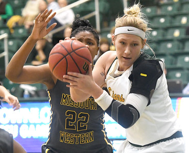Missouri Southern's Jenson Maydew gets past Missouri Western's Dossou Ndiaye (22) for a score during their game on Saturday afternoon at Leggett & Platt. Globe | Laurie Sisk