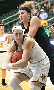 Missouri Southern's Desirea Buerge, front, and Northwest Missouri's Tanya Meyer battle for a rebound during their game on Thursday night at MSSU. Globe | Laurie Sisk