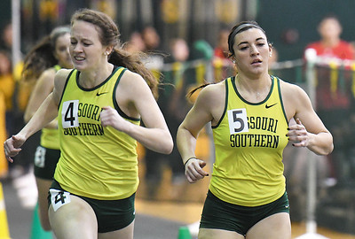 From the left: Rachel Ray stretches to beat teammate Ashlynn Vanetter in the women's 400m during the Southern Invite on Saturday at Leggett & Platt. Globe | Laurie Sisk