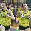 From the left: Rachel Ray stretches to beat teammate Ashlynn Vanetter in the women's 400m during the Southern Invite on Saturday at Leggett & Platt.<br /> Globe | Laurie Sisk