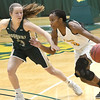 Missouri Southern guard Jasmine Green (11) challenges Missouri S&T's Marta Durk (3) during a game earlier this season at Leggett & Platt.<br /> Globe | Laurie Sisk