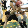 Missouri Southern's Desirea Buerge, center, battles Emporia State's Tatum Graves for a loose ball during their game on Saturday at Leggett & Platt.<br /> Globe | Laurie Sisk