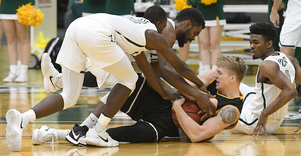 From the left: Missouri Southern's Elyjah Clark, LJ Ross and Koray Gilbert battle Missouri Western's Alex Martin for a loose ball during their game on Saturday afternoon at Leggett & Platt.<br /> Globe | Laurie Sisk