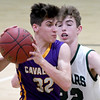 Thomas Jefferson's Chase Kellenberger (32) tries to get past College Heights' Conner Burton (22) during their game on Thursday night at CHCS.<br /> Globe | Laurie Sisk