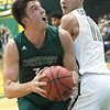 Northwest Missouri's Joey Witthus (30) looks to the rim as Missouri Southern's Kinzer Lambert (11) defends during their game on Thursday night at MSSU.<br /> Globe | Laurie Sisk