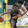 Emporia State's Brandon Hall (5) tries to get past the defense of Missouri Southern's Braelon Walker during their game on Saturday at MSSU.<br /> Globe | Laurie Sisk