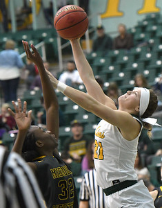 Missouri Southern's Desirea Buerge (21) scores on Missouri Western's Dossou Ndiaye (32) during their game on Saturday afternoon at Leggett & Platt. Globe | Laurie Sisk