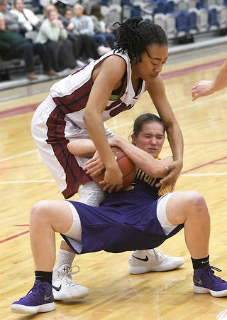Joplin's Malia Mack (15) and Camdenton's Shelby Kurtz (5) vie for a loose ball during their game on Friday night at JHS.<br /> Globe | Laurie Sisk