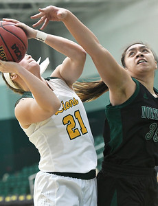 Missouri Southern's Desirea Buerge (21) puts up a shot as Northwest Missouri's Kaylani Maiava (35) defends during their game on Thursday night at MSSU. Globe | Laurie Sisk