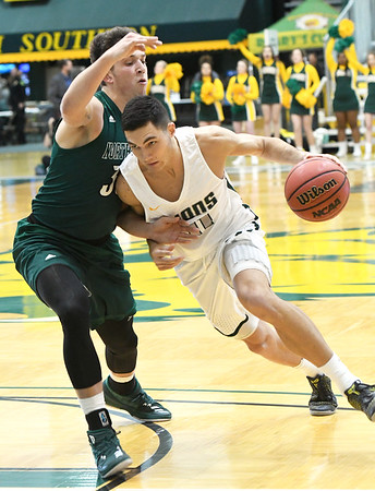 Northwest Missouri's Joey Witthus (30) tries to stop Missouri Southern's Kinzer Lambert (11) during their game on Thursday night at MSSU.<br /> Globe | Laurie Sisk