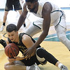 Emporia State's Grant Shell, front, and Missouri Southern's LJ Ross battle for a loose ball during their game on Saturday at Leggett & Platt.<br /> Globe | Laurie Sisk