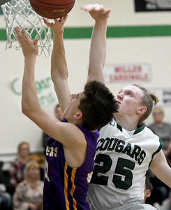 College Heights senior Logan Baker (25) tries to block a shot by Thomas Jefferson's Chase Kellenberger during their game on Thursday night at CHCS. Globe | Laurie Sisk