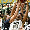 Missouri Southern's Christian Bundy (14) battles Washburn's Jace Williams (35) for a rebound during their game on Wednesday night at Leggett & Platt.<br /> Globe | Laurie Sisk
