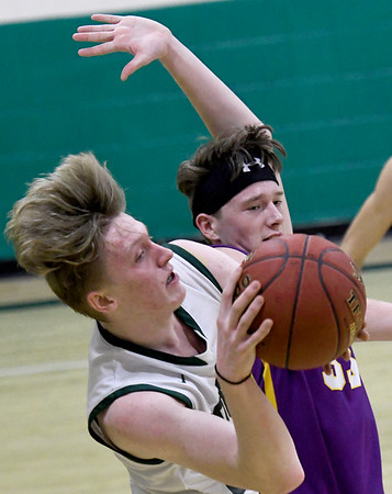 College Heights' Logan Baker (25) and Thomas Jefferson's Andrew Corle battle for a rebound during their game on Thursday night at CHCS.<br /> Globe | Laurie Sisk